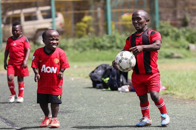 XDI11. Nairobi (Kenya), 29/05/2018.- Players of the Lion Stars, Kenya's first dwarf soccer team, after a training session at the City Stadium in Nairobi, Kenya, 29 May 2018 (issued 14 July 2018). Lion Stars is an eight member men's dwarf soccer team, the first of their kind in Kenya, with players aged between 18 and 47 years old. Led by Gabriel Ochieng, a volunteer coach, the team aims transition from a recreational to a competitive one. They are planning to head to Argentina for the Copa Argentina tournament in October 2018 for friendly matches they have been invited to. Dwarf soccer has different rules to the mainstream version, in the interests of player safety. Headers are banned, for instance, to prevent spinal injuries, and if a player heads the ball, the other team will be awarded a free kick. Lion Stars is the only dwarf soccer team in East Africa and is working towards bringing Tanzania, Uganda and Rwanda into the fold. However, the team is facing several challenges, including financial sponsorship that would enable them to further their sporting endeavors. 'We face the challenge of ground, we face a challenge of balls, we face challenge of corns, we face challenge of uniform,' volunteer coach Ochieng said. They have reached out to the Kenyan government and well-wishers for help. The team was established with the help of the 'Short Stature Society of Kenya' to help counter stigmatization against people of short stature in the country by engaging in activities such as motivational speaking, theater, and community work as well as sporting activities such as weight-lifting, badminton and soccer. (Futbol, Amistoso, Kenia, Ruanda) EFE/EPA/DANIEL IRUNGU ATTENTION: This Image is part of a PHOTO SET
