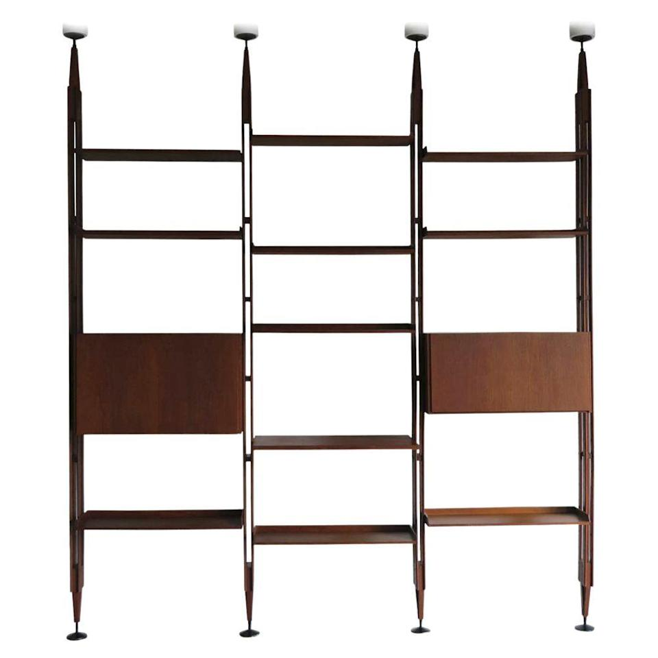 <p>This elegant modular and adjustable design was created by Albini in the 1950s for Poggi, a prominent maker of furniture in the mid-century era. A rare piece that's spurred many imitations, the 'LB7' has ceiling and floor fixings, allowing it to be used as a room divider as well as storage.</p>