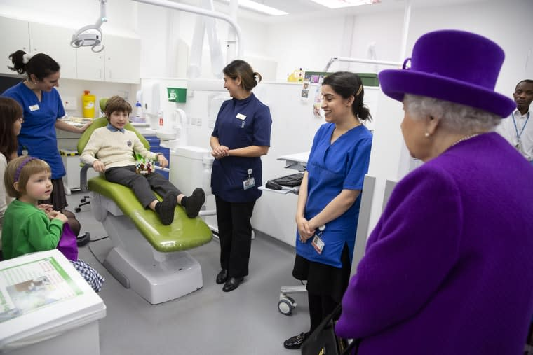 Queen Elizabeth II meeting 10 year old Ilia Aristovich who is having braces fitted during the official opening of the new premises of the Royal National ENT and Eastman Dental Hospitals in London.