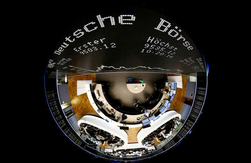 FILE PHOTO: The German share prize index board and the trading room of Frankfurt's stock exchange are photographed with a circular fisheye lens during afternoon trading session in Frankfurt
