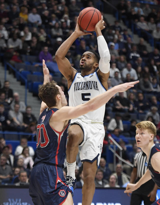 Villanova's Phil Booth (5) shoots over St. Mary's Tanner Krebs (0) during the first half of a first round men's college basketball game in the NCAA tournament, Thursday, March 21, 2019, in Hartford, Conn. (AP Photo/Jessica Hill)
