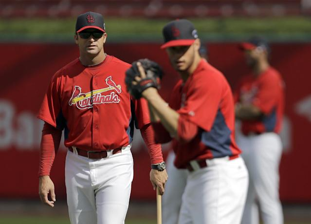 St. Louis Cardinals manager Mike Matheny, left, watches as pitcher Joe Kelly throws during practice for the National League baseball championship series Thursday, Oct. 10, 2013, in St. Louis. Kelly will be the Cardinals' starter when the Cardinals play the Los Angeles Dodgers in Game 1 of the NLCS scheduled for Friday in St. Louis. (AP Photo/Jeff Roberson)