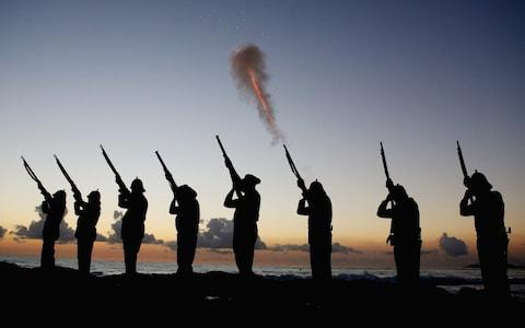 Members of the Albert Battery shoot a volley of fire during the Anzac dawn service at Currumbin Surf Life Saving Club in Australia - Credit: Chris Hyde/Getty Images