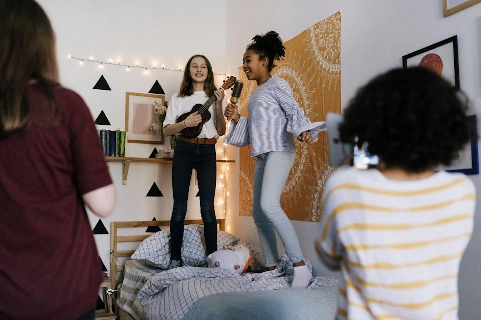 <p>Pull out those hairbrush microphones and blast your favorite tunes for a family dance party! Let each child play DJ for a few songs so there's no battling over music choices, and give prizes for inventive dance moves. Can your little ones do the worm?</p>
