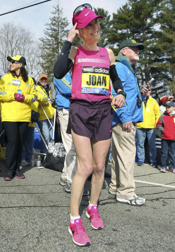 FILE - In this April 15, 2013 file photo, Joan Benoit Samuelson warms up in Hopkinton, Mass., prior to the start of the 117th running of the Boston Marathon. The Boston Athletic Association, which organizes the race, said Friday, March 15, 2019, that the two-time champion and Olympic gold medalist will be in the field for the 123rd running of the Boston Marathon on Monday, April 15. (AP Photo/Stew Milne, File)