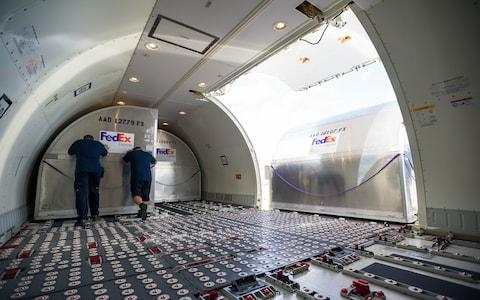 Cargo airlines are stripped of seats and ready for freight - Credit: Fedex