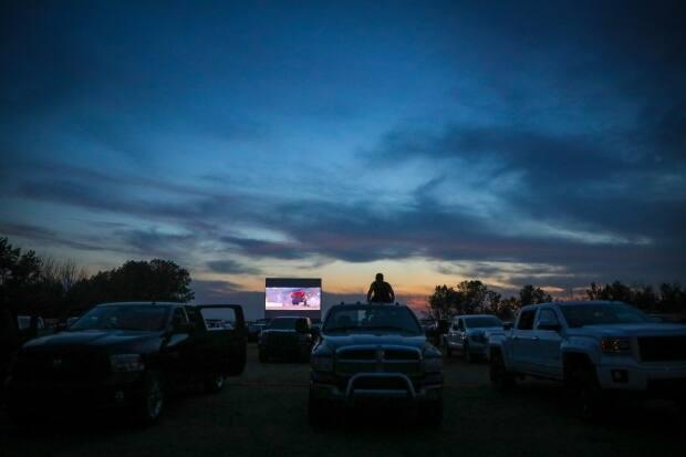 Cloudy and colourful skies provided a beautiful backdrop during a drive-in movie at the High River Sunset Drive-In last summer. The province has reversed last week's restriction on drive-in theatres, now allowing them to open with COVID-19 protocols. (Leah Hennel for CBC News - image credit)