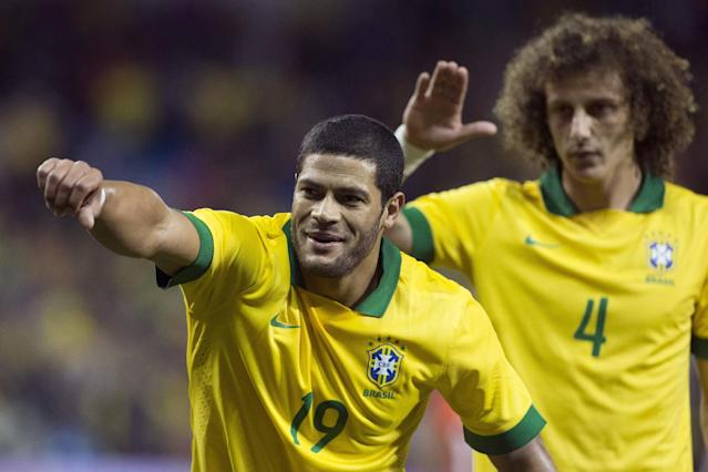 Brazil's Hulk (left) celebrates scoring his team's opening goal against Chile as teammate David Luiz looks on during first half action of their international friendly match in Toronto on Tuesday, Nov. 19, 2013. (AP Photo/The Canadian Press, Chris Young)