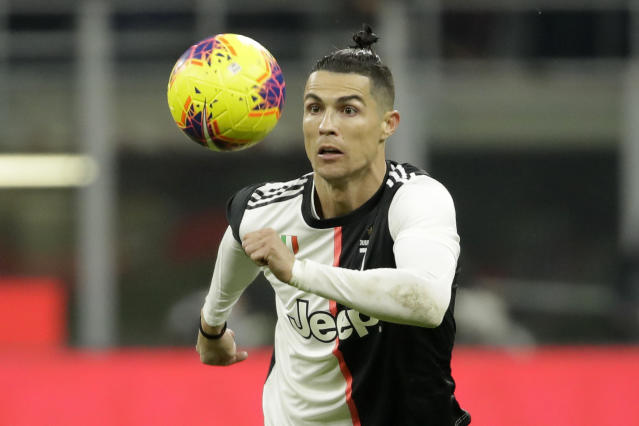 Juventus' Cristiano Ronaldo eyes the ball during an Italian Cup soccer match between AC Milan and Juventus at the San Siro stadium, in Milan, Italy, Thursday, Feb. 13, 2020. (AP Photo/Luca Bruno)