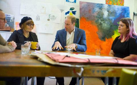 The prince talks with former clients Jason, Heather and Grace - Credit: DAVID ROSE/AFP/Getty Images