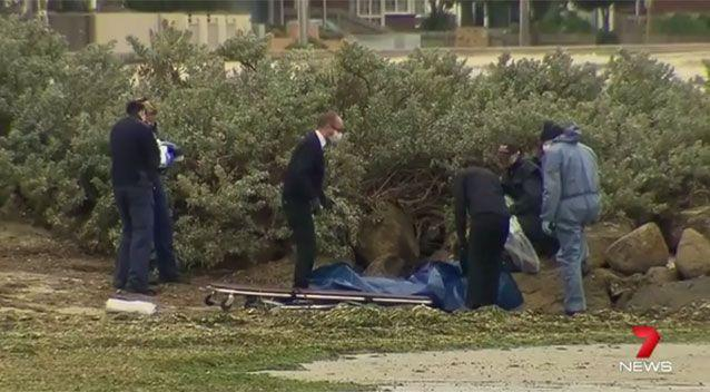A woman's badly burnt body was found at Altona Beach Esplanade.