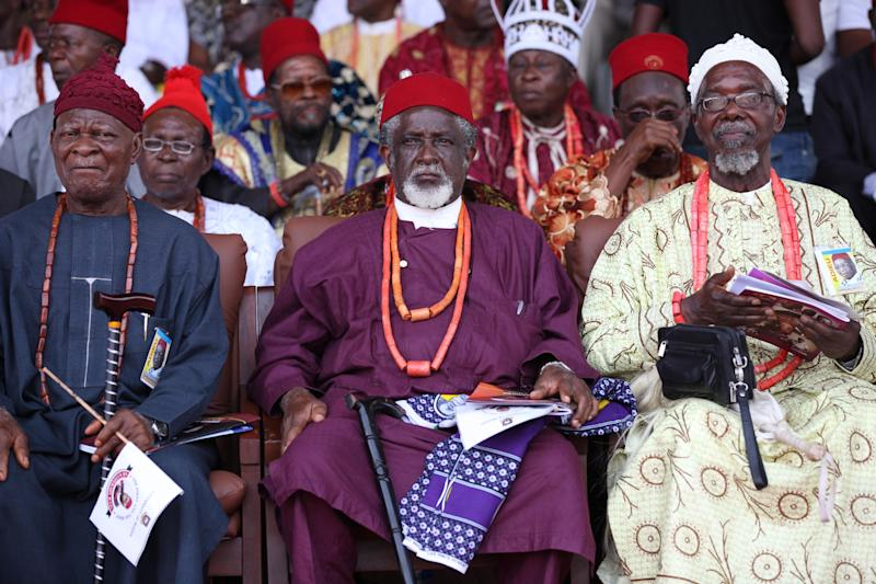 Unidentified traditional Igbo chiefs attend an event to celebrate the life of late author Chinua Achebe in Awka, Nigeria, Wednesday, May 22, 2013. People gathered Wednesday to celebrate the life of author Chinua Achebe, who died in March at the age of 82. His family plans to bury the literary icon Thursday in his home village of Ogidi. (AP Photo/Sunday Alamba)