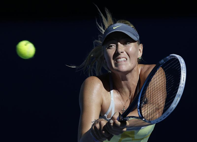 Russia's Maria Sharapova hits a backhand return to compatriot Ekaterina Makarova during their quarterfinal match at the Australian Open tennis championship in Melbourne, Australia, Tuesday, Jan. 22, 2013. (AP Photo/Andy Wong)