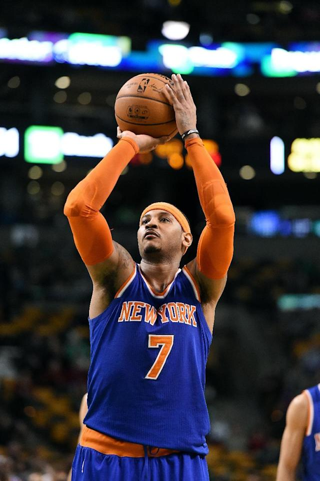 BOSTON, MA - DECEMBER 12: Carmelo Anthony #7 of the New York Knicks attempts a free throw against the Boston Celtics on December 12, 2014 at the TD Garden in Boston, Massachusetts. (Photo by Brian Babineau /NBAE via Getty Images)