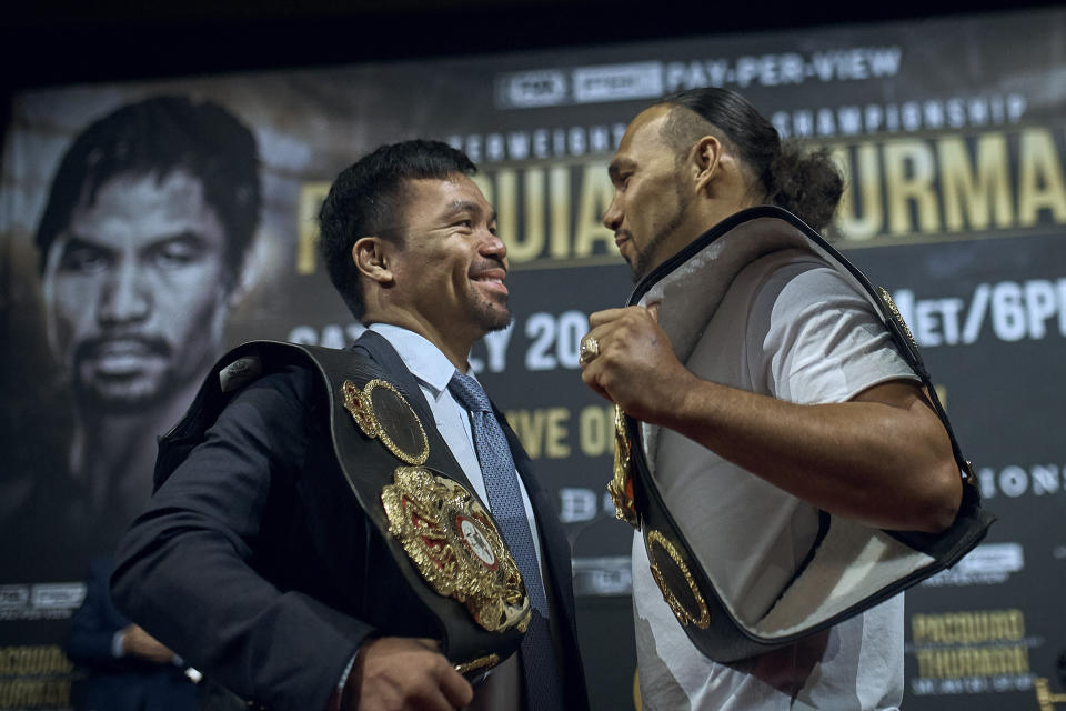 Manny Pacquiao, left, and Keith Thurman stand face to face during a news conference on Tuesday, May 21, 2019, in New York. The two are scheduled to fight in a welterweight world championship boxing bout on Saturday, July 20, in Las Vegas. (AP Photo/Andres Kudacki)