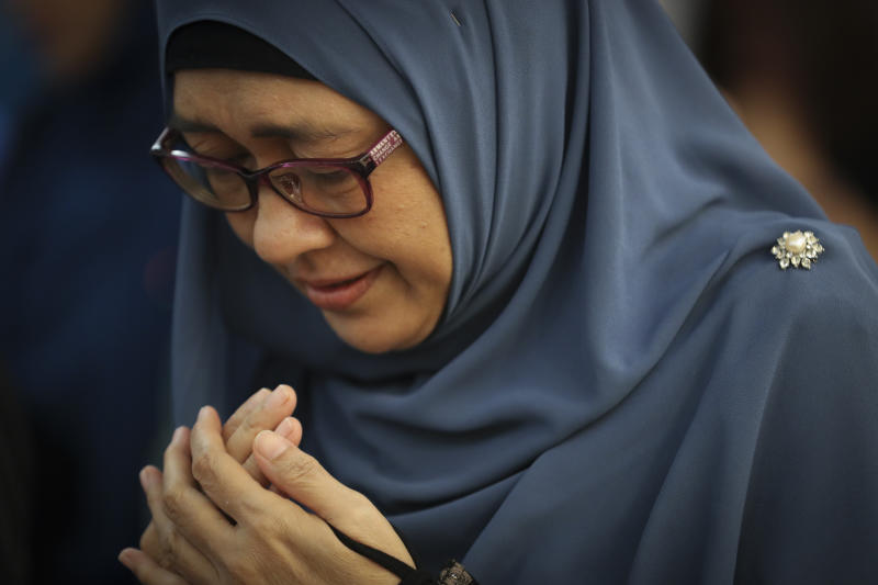 A woman prays as friends and family of victims from Malaysia Airlines Flight MH17 plane crash attend a ceremony marking the fifth anniversary of the tragedy in Kuala Lumpur, Malaysia, Wednesday, July 17, 2019. Five years after a missile blew Malaysia Airlines Flight 17 out of the sky above eastern Ukraine, relatives and friends of those killed gathered Wednesday in Kuala Lumpur and at a Dutch memorial to mark the anniversary. (AP Photo/Vincent Thian)