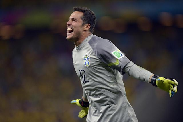 Brazil's goalkeeper Julio Cesar celebrates after David Luiz scored his side's second goal during the World Cup quarterfinal soccer match between Brazil and Colombia at the Arena Castelao in Fortaleza, Brazil, Friday, July 4, 2014