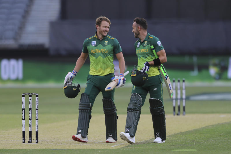 South Africa's David Miller (left) and Faf du Plessis leave the pitch after defeating Australia in their one-day international cricket match in Perth, Sunday, Nov. 4, 2018. (AP Photo/Trevor Collens)