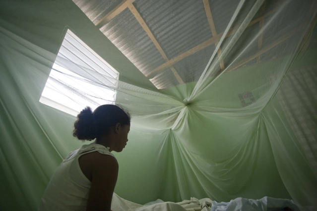 <p>Alicia sits on her bed at her home in Las Matas de Farfan, Dominican Republic on June 12, 2009. (© Tatiana Fernandez) </p>