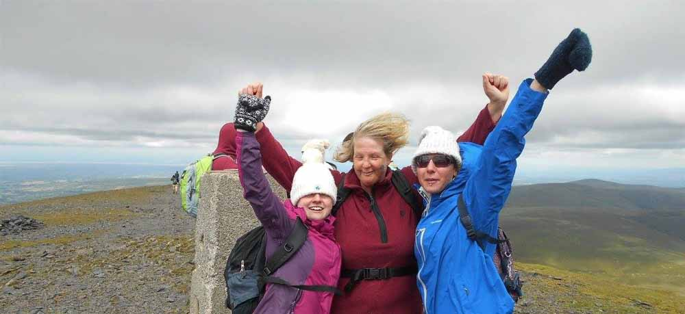 Lisa, Nicky and Michelle celebrate at the summit of Skiddaw (PA Real Life/Collect)