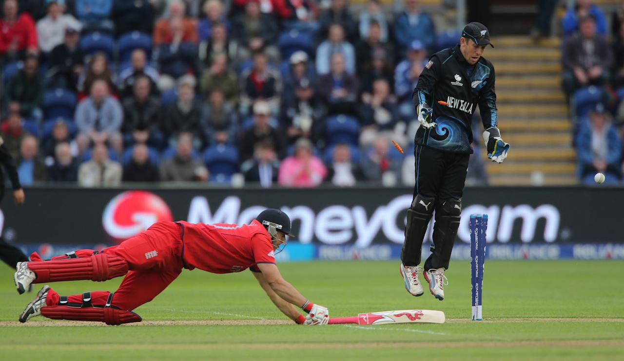 England's Tim Bresnan is run out by a throw from a New Zealand fielder as wicketkeeper Luke Ronchi celebrates during the ICC Champions Trophy match at the SWALEC Stadium, Cardiff.