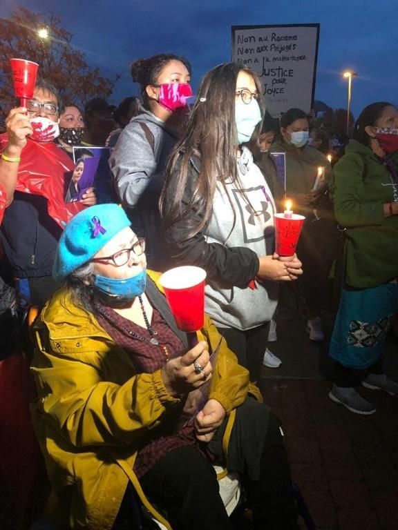 People attend a candlelight vigil in memory of Joyce Echaquan on September 29, 2020, near Joliette Hospital, near Montreal, Quebec