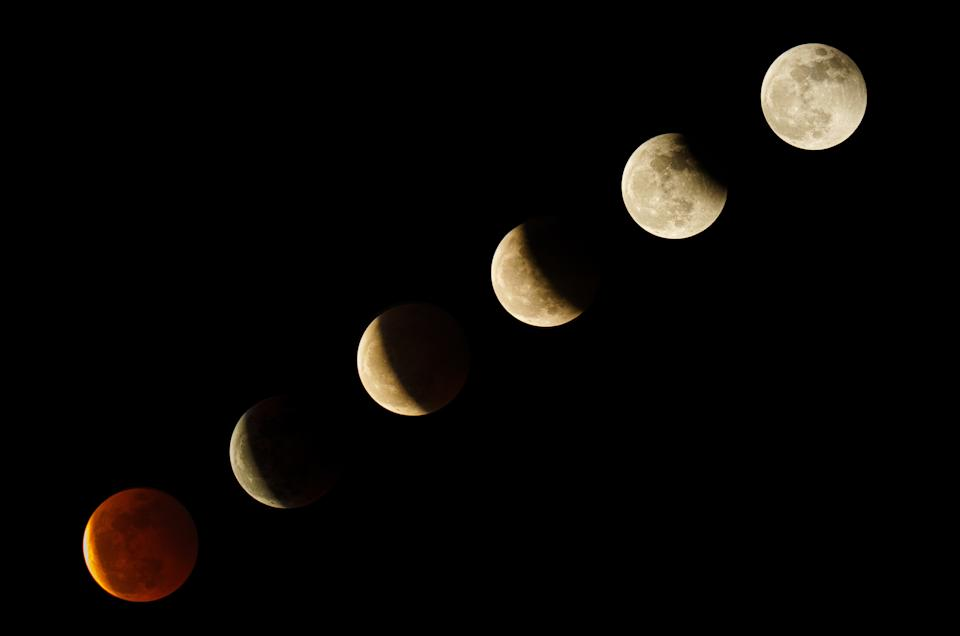 DONGGUAN, CHINA - MAY 26: (EDITOR'S NOTE: COMPOSITE IMAGE) Composite of the moon in various stages of the Super Blood Moon total lunar eclipse on May 26, 2021 in Gongguan, Guangdong Province of China. (Photo by VCG/VCG via Getty Images)