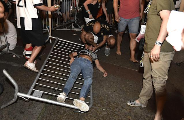<p>A Juventus' fan receives first aids as the fans gathered in San Carlo Square run away following panic created by the explosion of firecrackers as they was watching the match on a giant screen on June 3, 2017. (Giorgio Perottino/Reuters) </p>