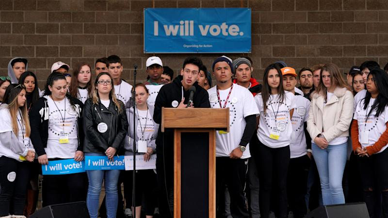 Carlos Rodriguez speaking at teen voter registration rally