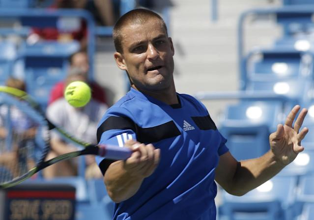 Mikhail Youzhny, from Russia, hits a forehand against Andy Murray, from Great Britain, during a match at the Western & Southern Open tennis tournament, Wednesday, Aug. 14, 2013, in Mason, Ohio. Murray won 6-2, 6-3. (AP Photo/Al Behrman)