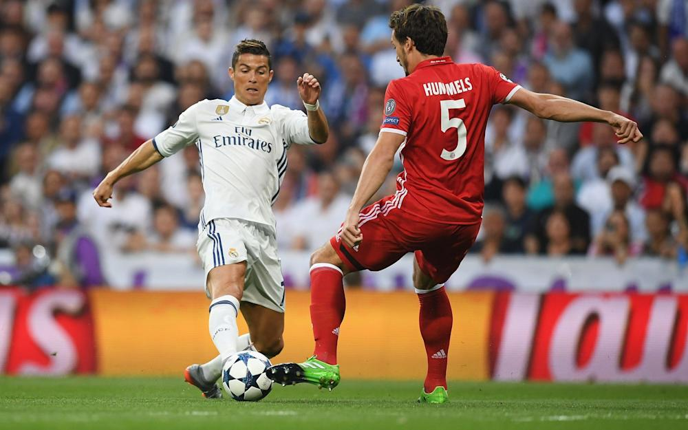 Cristiano Ronaldo of Real Madrid and Mats Hummels of Bayern Muenchen - Credit: GETTY