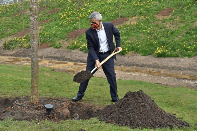 Mayor of London Sadiq Khan helps to plant trees