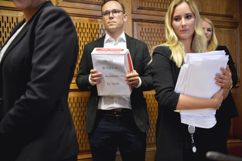 Lawyers gather for the verdict on American rapper A$AP Rocky at Stockholm District Court, in Stockholm, Sweden, Wednesday Aug. 14, 2019.  The Swedish court on Wednesday found American rapper A$AP Rocky guilty of assault for his role in a June 30 street brawl in Stockholm. (Anders Wiklund / TT via AP)