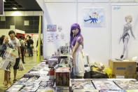 <p>A dressed up stall attendant at a booth selling anime merchandise at Asia Game Festival 2018. (PHOTO: Don Wong) </p>