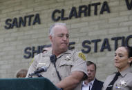 Deputy James Callahan, at podium, takes questions from the media at a news conference at the station Santa Clarita, Calif., Friday, Nov. 15, 2019. Callahan works as a school resource officer at Saugus High School, was on the scene in the aftermath of the shooting, (AP Photo/Damian Dovarganes)