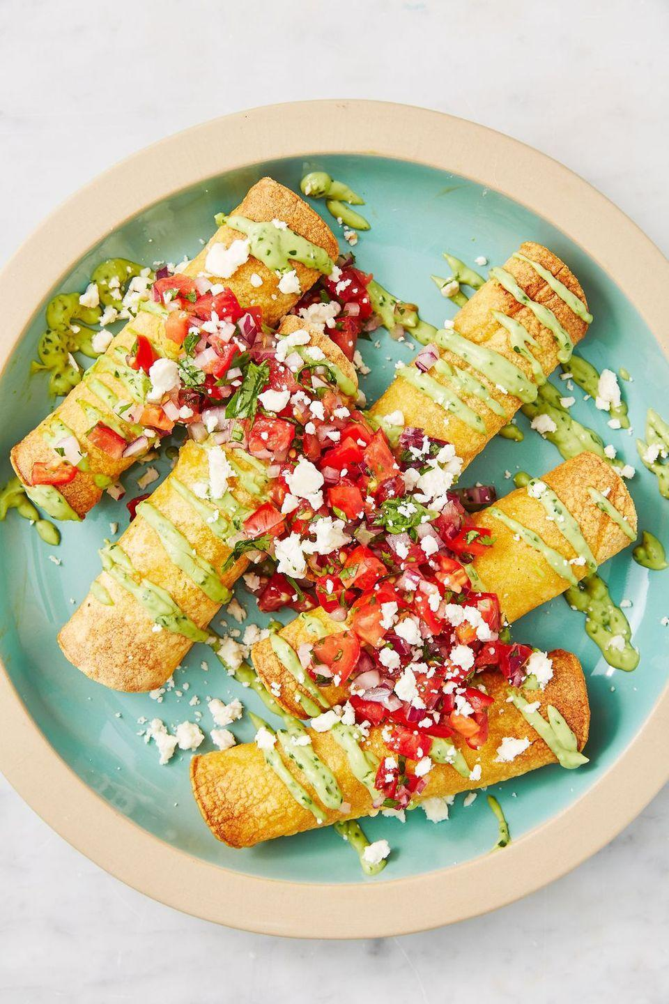 "<p>These extra thin and extra crispy treats have all the flavor of tacos with a little extra crunch.</p><p><em><a href=""https://www.delish.com/cooking/recipe-ideas/a28577904/chicken-taquitos-recipe/"" rel=""nofollow noopener"" target=""_blank"" data-ylk=""slk:Get the recipe from Delish »"" class=""link rapid-noclick-resp"">Get the recipe from Delish »</a></em></p>"