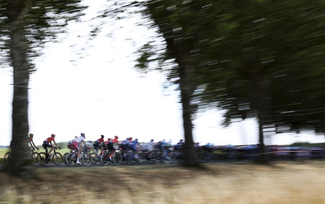 The pack ride during the eleventh stage of the Tour de France cycling race over 167 kilometers (103,77 miles) with start in Albi and finish in Toulouse, France, Wednesday, July 17, 2019. (AP Photo/Thibault Camus)