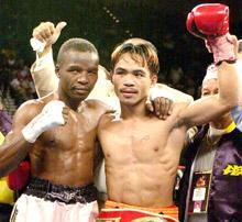 Pacquiao celebrates his victory over Lehlo Ledwaba of South Africa