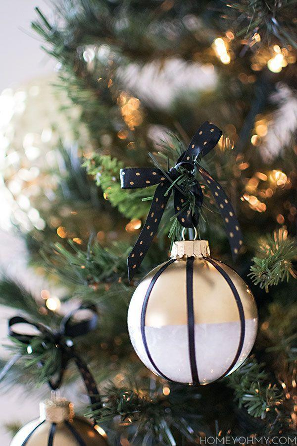 "<p>Stripes will never go out of style—especially when they're black, and paired with gold and white.</p><p>Get the tutorial at <a href=""http://www.homeyohmy.com/diy-black-white-gold-ornaments/"" rel=""nofollow noopener"" target=""_blank"" data-ylk=""slk:Homey Oh My!"" class=""link rapid-noclick-resp"">Homey Oh My!</a>.</p>"