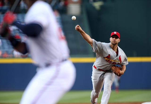 St. Louis Cardinals starting pitcher Adam Wainwright (50) delivers a pitch to Atlanta Braves Freddie Freeman in the first inning of a baseball game, Wednesday May 7, 2014, in Atlanta. (AP Photo/Jason Getz)