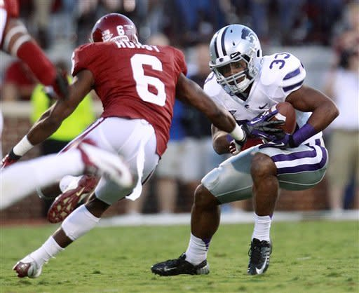 Kansas State runing back John Hubert (33) carries as Oklahoma defender Demontre Hurst (6) moves in, during the first quarter of an NCAA college football game in Norman, Okla., Saturday, Sept. 22, 2012. (AP Photo/Sue Ogrocki)