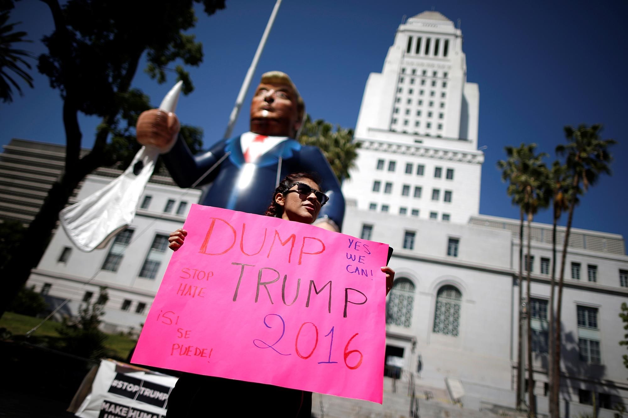 Dump Trump: A protester holds an effigy of Donald Trump at an immigrant rights May Day march in Los Angeles, Calif. (Photo: Lucy Nicholson/Reuters)