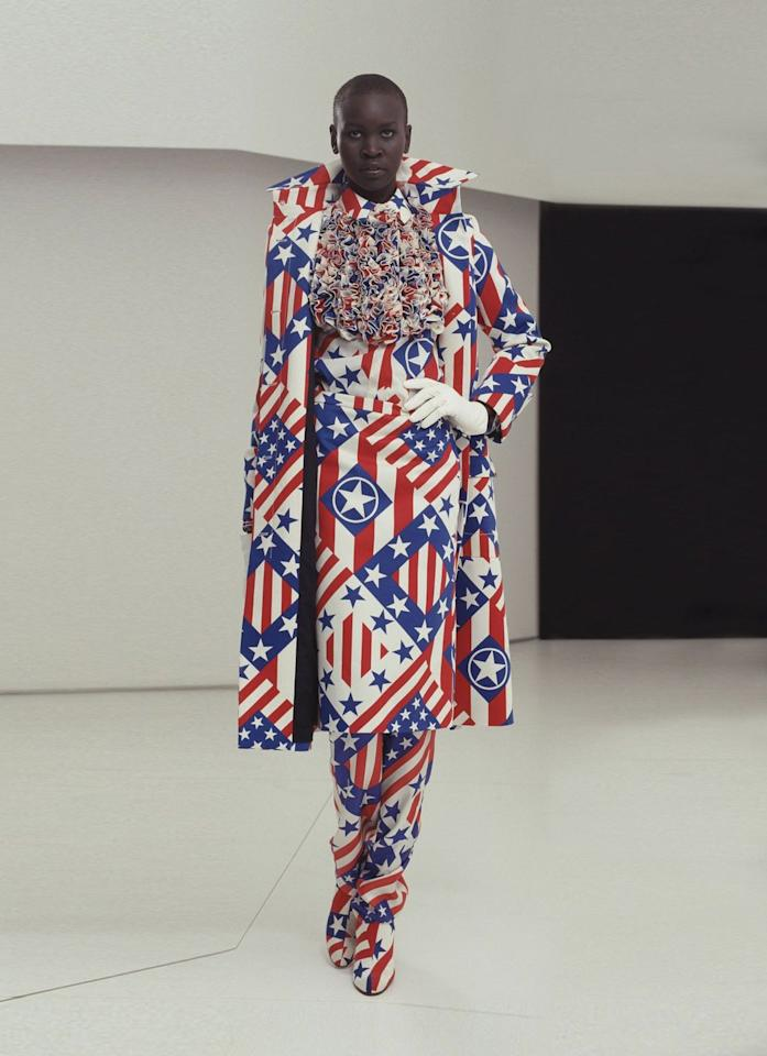 <p>Alek Wek pays homage to America in this red, white, and blue look.</p>