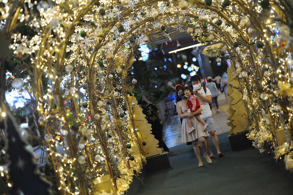 People taking photos with the Christmas along the shopping belt of Orchard Road on 16 December. (PHOTO: Getty Images)