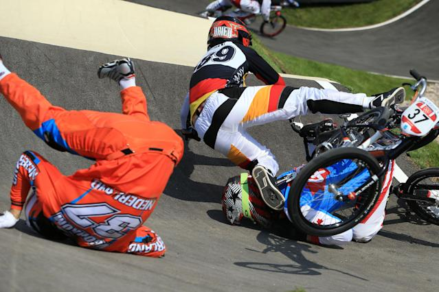 LONDON, ENGLAND - AUGUST 09: (L-R) Jelle Van Gorkom of Netherlands, Maik Baier of Germany, and Tory Nyhaug of Canada crash during the Men's BMX Cycling Quarter Finals on Day 13 of the London 2012 Olympic Games at BMX Track on August 9, 2012 in London, England. (Photo by Phil Walter/Getty Images)