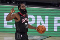 Houston Rockets' James Harden (13) signals to the offense during the second half of an NBA first-round playoff basketball game in Lake Buena Vista, Fla., Wednesday, Sept. 2, 2020. (AP Photo/Mark J. Terrill)