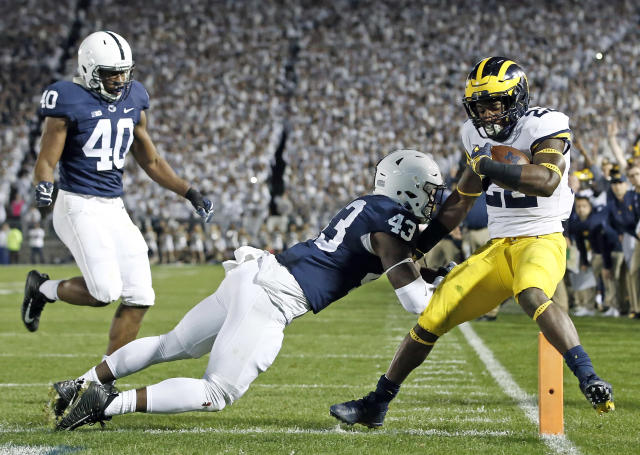 "Penn State's <a class=""link rapid-noclick-resp"" href=""/ncaaf/players/256701/"" data-ylk=""slk:Manny Bowen"">Manny Bowen</a> (43) hits Michigan's <a class=""link rapid-noclick-resp"" href=""/ncaaf/players/256587/"" data-ylk=""slk:Karan Higdon"">Karan Higdon</a> (22) as he scores a touchdown during the first half of an NCAA college football game in State College, Pa., Saturday, Oct. 21, 2017. (AP Photo/Chris Knight)"