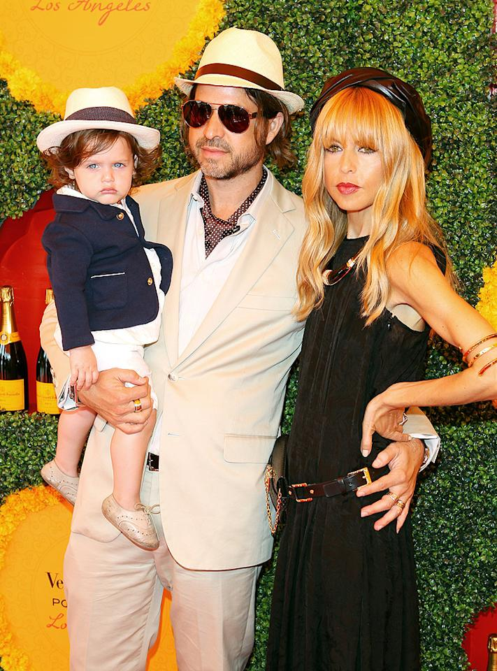 Stylist and reality star Rachel Zoe, who hosted the event along with Argentine polo player Nacho Figueras, popped a pose with her two stylish dates: hubby Rodger Berman and their 18-month-old son Skyler. The trio was decked out to match the event's theme of a famous polo match in 1922 India, with both boys donning suits and panama hats, and Zoe wearing a flapper-style dress and a vintage Dior turban.