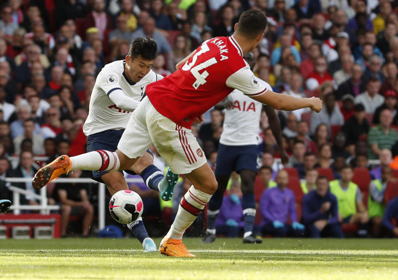 Tottenham's Son Heung-min shoots at goal during their English Premier League soccer match between Arsenal and Tottenham Hotspur at the Emirates stadium in London, Sunday, Sept. 1, 2019. (AP Photo/Alastair Grant)
