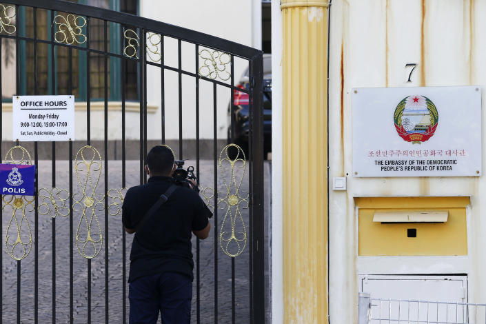 A journalist films outside the North Korean Embassy in Kuala Lumpur, Malaysia, Saturday, March 20, 2021. Malaysia said Friday it will order all North Korean diplomats to leave the country within 48 hours, an escalation of diplomat brawl over Malaysia's move to extradite a North Korean suspect to the United States for money laundering charges. (AP Photo/Lai Seng Sin)